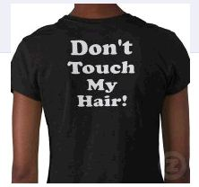 Trying to Put a T-Shirt On Without Messing Up Your Hair